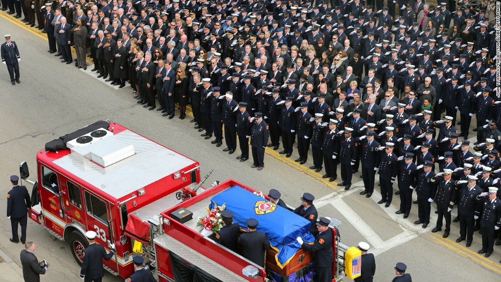 "Firefighters from across the country take part in the funeral services for Boston firefighter Edward J. Walsh Jr. on Wednesday, April 2, in Watertown, Massachusetts. Walsh was one of two firefighters, along with Michael Kennedy, who died battling a <a href=""http://www.cnn.com/2014/03/26/us/boston-fire/index.html"">nine-alarm fire</a> in Boston's Back Bay neighborhood on March 26."