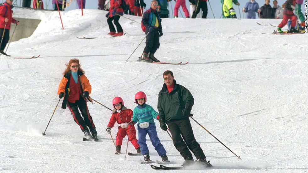 Prince Andrew, the Duke of York, and his then-wife Sarah, the Duchess of York, ski with their daughters, Beatrice and Eugenie, in Verbier, Switzerland, in February 1997.