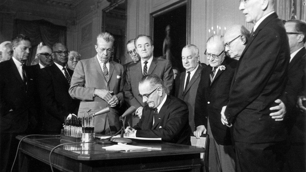 On July 2, 1964, President Lyndon Johnson signs the Civil Rights Act in the East Room of the White House in Washington.