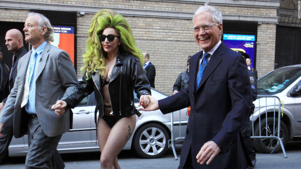 David Letterman gallantly assists Lady Gaga across the street ahead of her performance at New York's Roseland Ballroom on April 2.