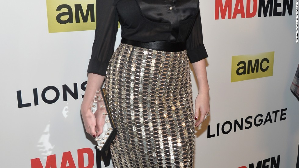 "Christina Hendricks illuminates her famous curves with a glittering skirt at the April 2 premiere of ""Mad Men's"" seventh season."