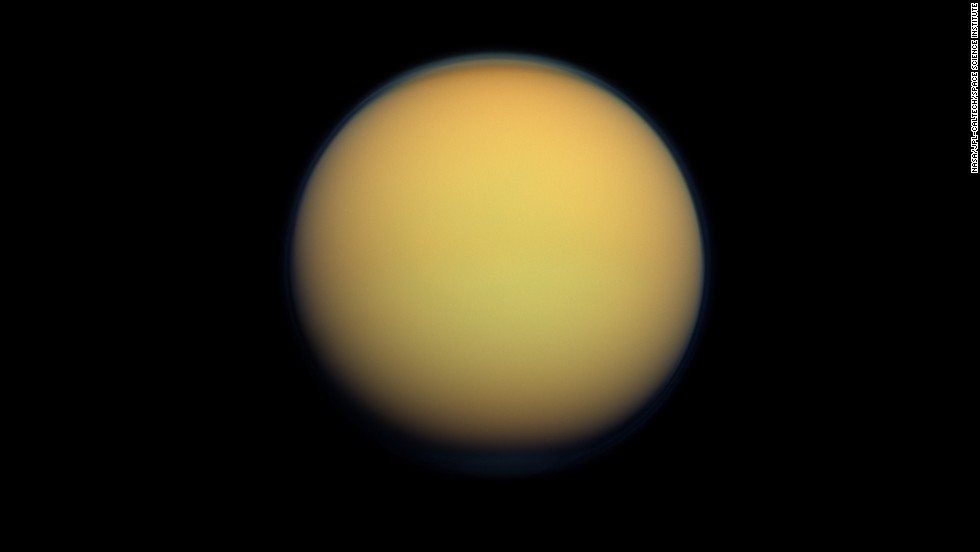 Saturn's largest moon, Titan, has a diameter of 3,200 miles. It looks like a fuzzy orange ball because of its atmosphere.