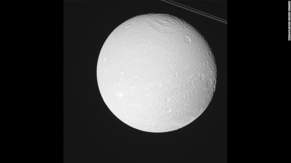 Saturn has a small moon called Dione orbiting about 234,000 miles away. That's about the same distance Earth is from its moon.