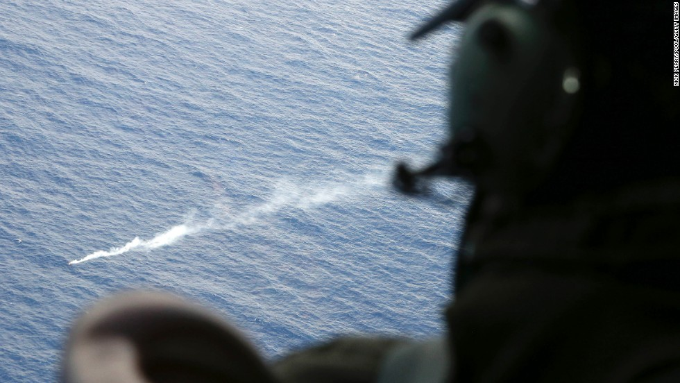 A member of the Royal New Zealand Air Force looks at a flare in the Indian Ocean during search operations on April 4, 2014.