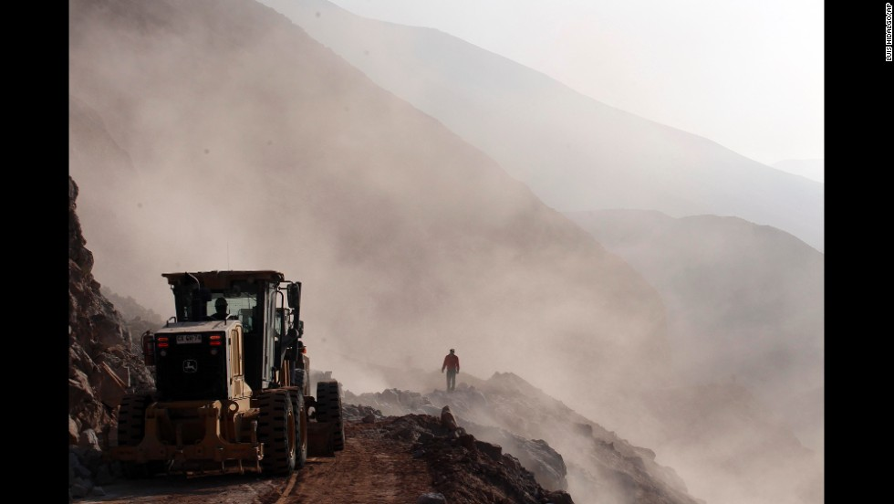 Heavy machinery is used to clear debris on the road leading to the town of Camarones, Chile, on Thursday, April 3. Access to the town was cut off when an 8.2-magnitude earthquake struck northern Chile on April 1.