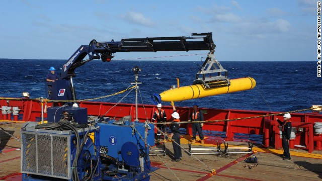 In this handout image provided by the U.S. Navy, The Bluefin 21, Artemis autonomous underwater vehicle (AUV) is hoisted back on board the Australian Defence Vessel Ocean Shield after successful buoyancy testing April 1, 2014 in the Indian Ocean.