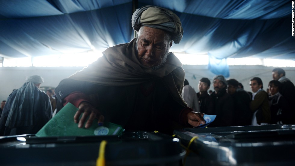 A man casts his vote at a polling station in Kabul.