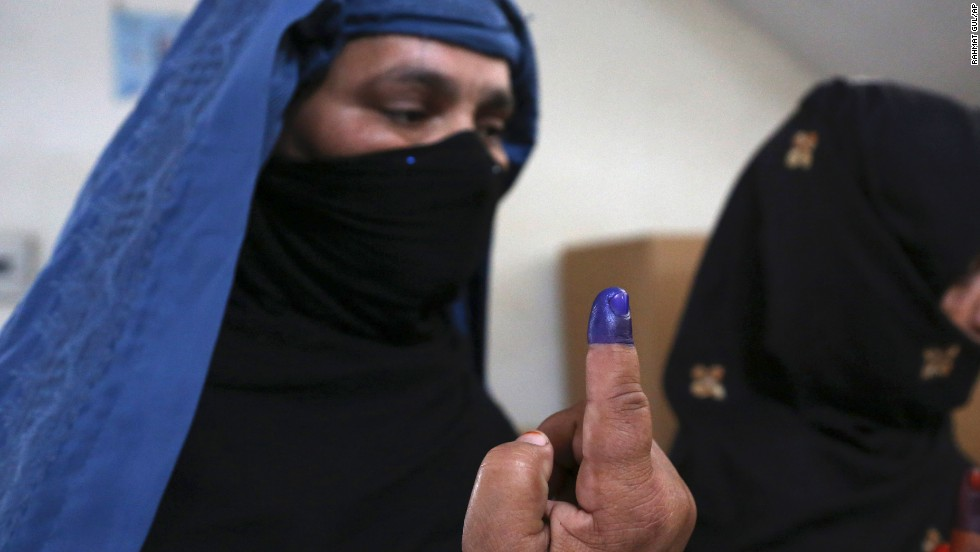 Afghan women show inked fingers after casting their votes at a polling station in Jalalabad, Afghanistan, on April 5. Despite threats from the Taliban to disrupt the vote and punish all involved, Afghans remain enthusiastic about the election. The top presidential contenders are Ashraf Ghani, Abdullah Abdullah and Zalmai Rassoul. The winner will replace President Hamid Karzai.
