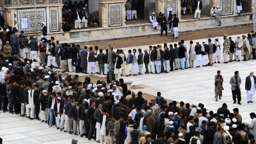 Afghans wait in long lines for their chance to cast a vote.