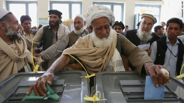 An Afghan man casts his vote at a polling station in Jalalabad, Afghanistan, on Saturday, April 5. Afghan voters lined up for blocks at polling stations nationwide on Saturday, defying a threat of violence by the Taliban to cast ballots in what promises to be the nation's first democratic transfer of power. There were few instances of violence.