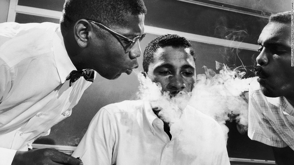 As part of his training for sit-in protests in 1960, student Virginius Thornton practices not reacting to smoke being blown in his face.