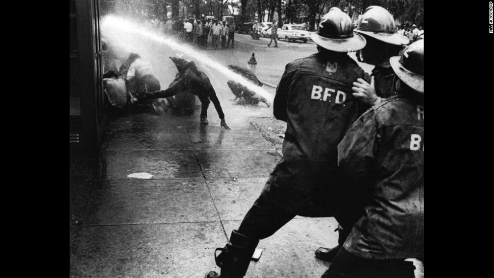 Firefighters turn their hoses on demonstrators in Birmingham in July 1963. When civil rights protesters stalled in Birmingham, the city's African-American children took to the streets. Their bravery facing water hoses and dogs riveted the nation.