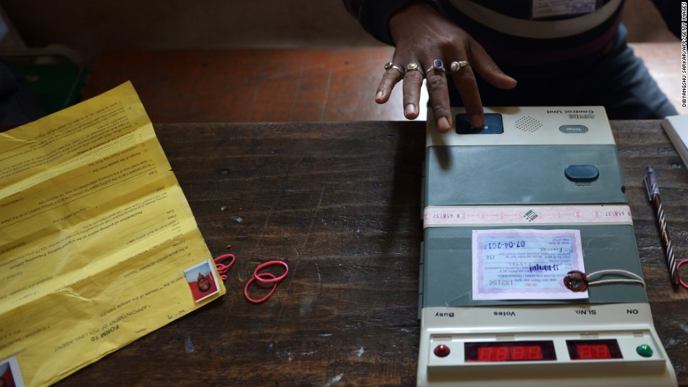A polling official in Dibrugarh tests an electronic voting machine prior to the start of voting April 7.