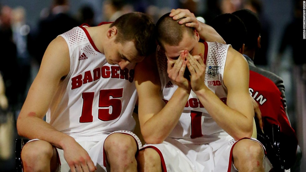 Wisconsin basketball players Sam Dekker, left, and Ben Brust react after losing to Kentucky in the Final Four of the NCAA Tournament on Saturday, April 5.