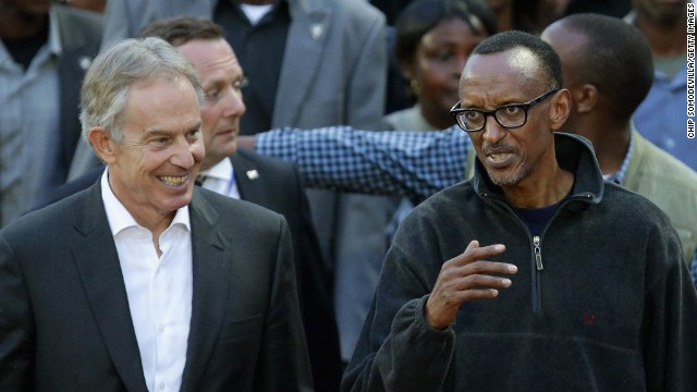 Former British Prime Minister Tony Blair (L) and Rwandan President Paul Kagame lead the Walk to Remember into Amahoro Stadium during the 20th anniversary commemoration of the 1994 genocide April 7, 2014 in Kigali, Rwanda.
