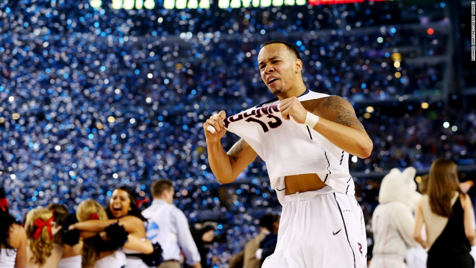 Shabazz Napier of the Connecticut Huskies celebrates on the court after his team defeated Kentucky in the final of the NCAA Tournament on Monday, April 7.