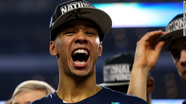 ARLINGTON, TX - APRIL 07: Shabazz Napier #13 of the Connecticut Huskies celebrates on the court after defeating the Kentucky Wildcats 60-54 in the NCAA Men's Final Four Championship at AT&T Stadium on April 7, 2014 in Arlington, Texas.  (Photo by Ronald Martinez/Getty Images)