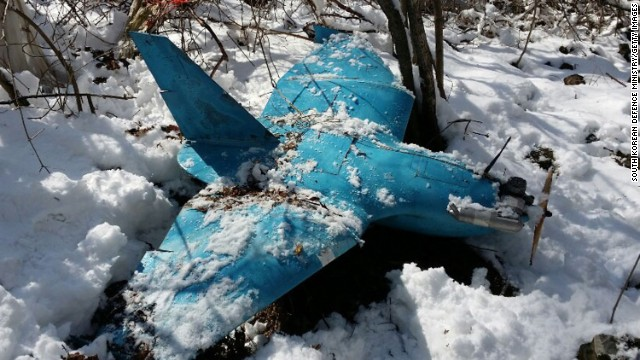 The wreckage of a crashed unmanned aerial vehicle on a mountain in Samcheok, South Korea on April 6, 2014.