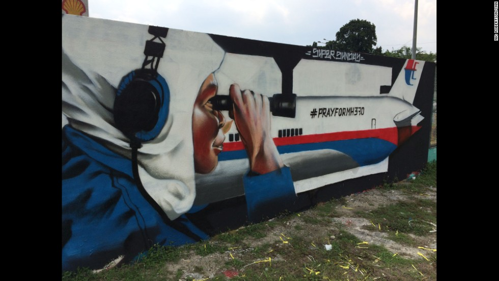 """MH370 wall art in Kuala Lumpur, Malaysia - still hopeful for survivors.  Defense Minister Hishammuddin said Monday they cannot rule out that possibility, despite earlier statements indicating that improbable."" By CNN's Nic Robertson, April 8.  Follow Nic on Instagram at <a href=""http://instagram.com/nicrobertsoncnn"" target=""_blank"">instagram.com/nicrobertsoncnn</a>."