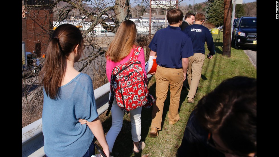 Students walk away from the campus on April 9.