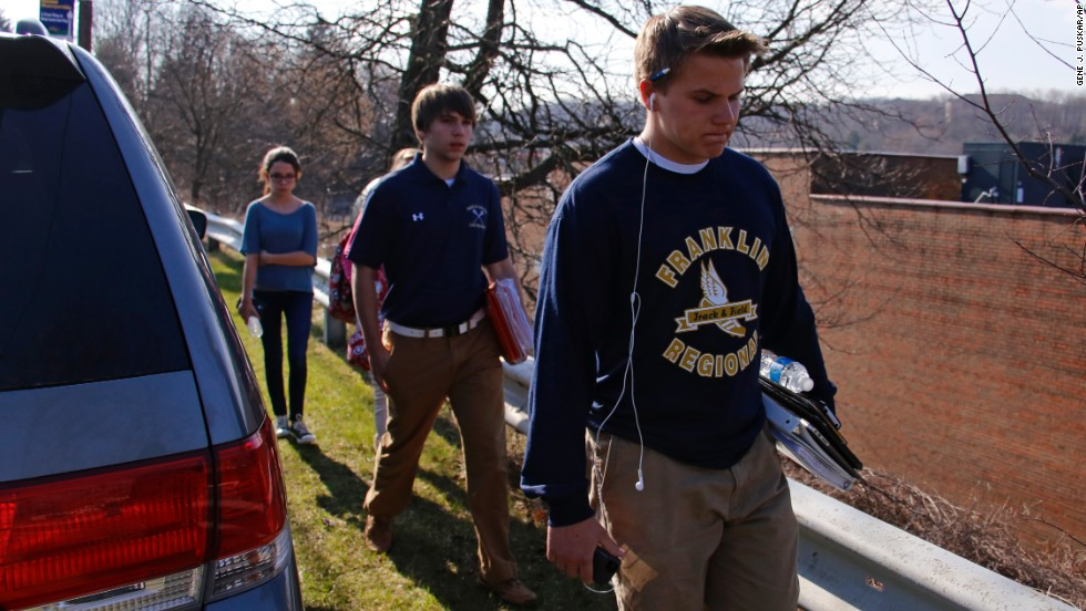 Students leave the school's campus on April 9.