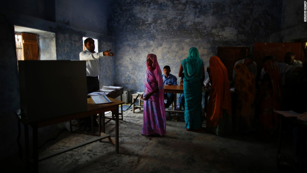 A woman is given directions by a polling station officer in Haryana on April 10.
