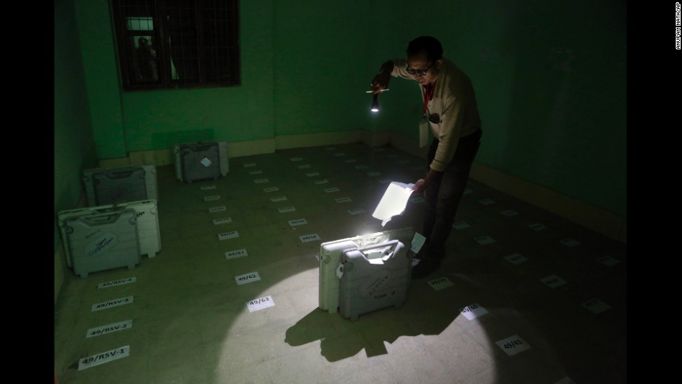 A polling officer checks the number of an electronic voting machine after it was deposited in Senapati, India, on Wednesday, April 9.