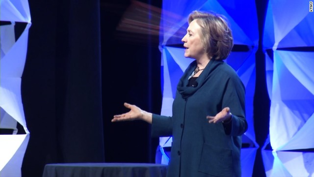 Hillary Clinton dodges a shoe on stage