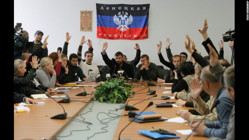 "Members of the self-proclaimed government the ""Donetsk Republic"" vote April 10 during a meeting at the seized regional administration building in Donetsk."