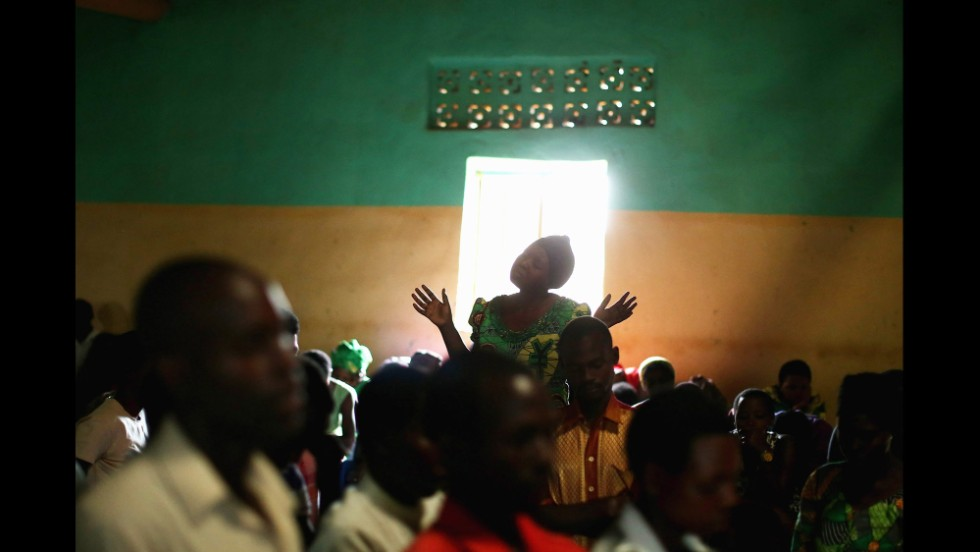 Rwandans worship during a Sunday service at the Chapel Mbyo on April 6 in Mybo. Some scholars say Christian leaders gave moral sanction to the genocide.