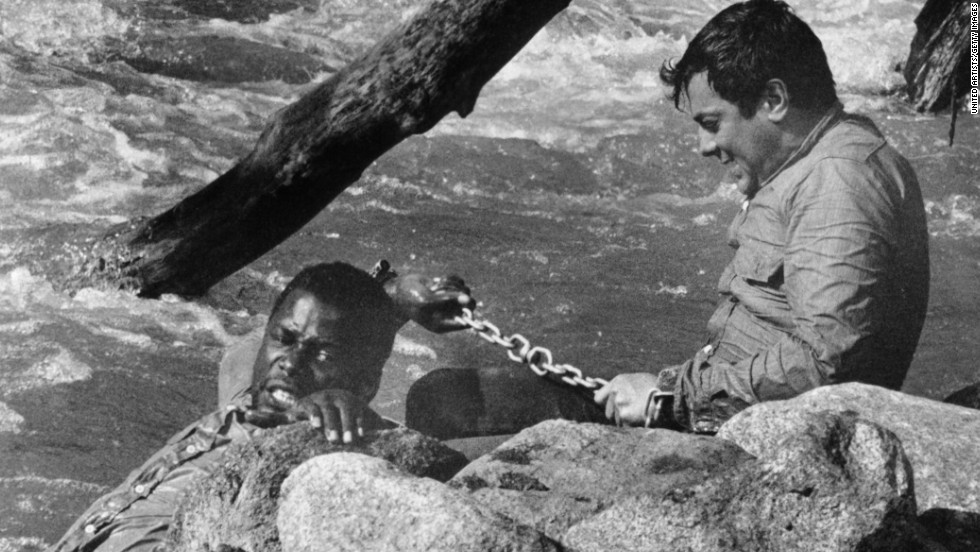 "Poitier was paired with Hollywood A-lister Tony Curtis in 1958's ""The Defiant Ones."" It's a story of two escaped prisoners, a black man and a white man, who are chained together and have to learn to respect and work with each other. Poitier was nominated for an Oscar, becoming the first black man to earn a best actor nod. The film was directed by Stanley Kramer, who was known for his message movies."
