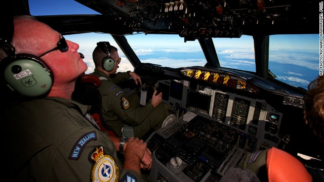 A Royal New Zealand Air Force P-3 Orion is flown by Flt. Lt Tim McAlevey back, in the search for missing Malaysia Airlines Flight MH370 over the Indian Ocean, Friday, April 11, 2014.