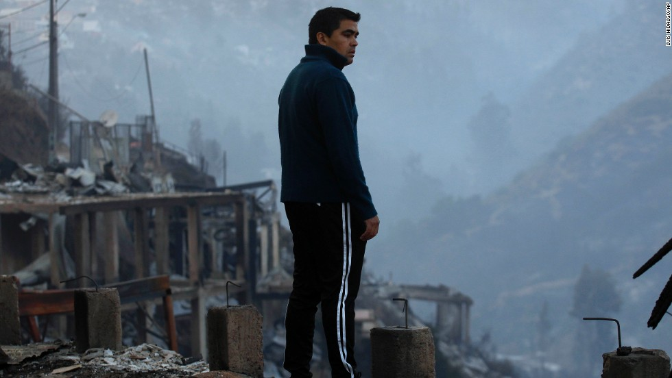 A man looks at the charred remains of homes in Valparaiso on April 13.