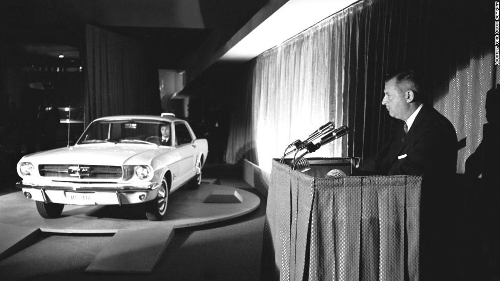 The 1965 Ford Mustang is officially revealed at the New York World's Fair in Flushing, New York, on April 17, 1964. Standard equipment for the car included carpet, bucket seats and a 170-cubic-inch, six-cylinder engine that was coupled with a three-speed floor-shift transmission.