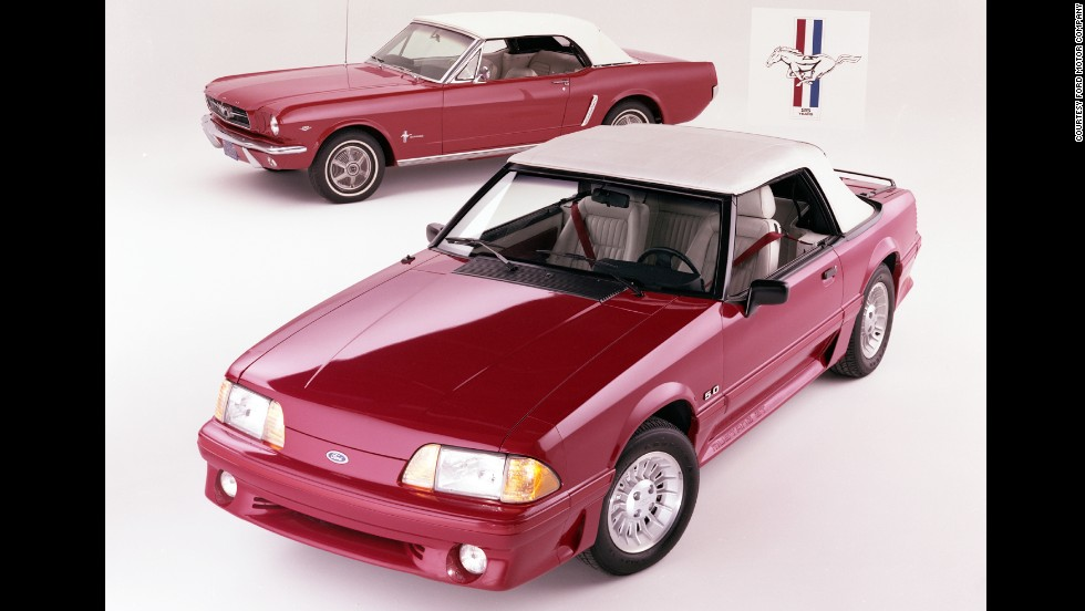 <strong>1990 Ford Mustang convertible, front, and 1965 Ford Mustang convertible. </strong>In 1990, Ford added a driver's-side airbag as standard equipment.