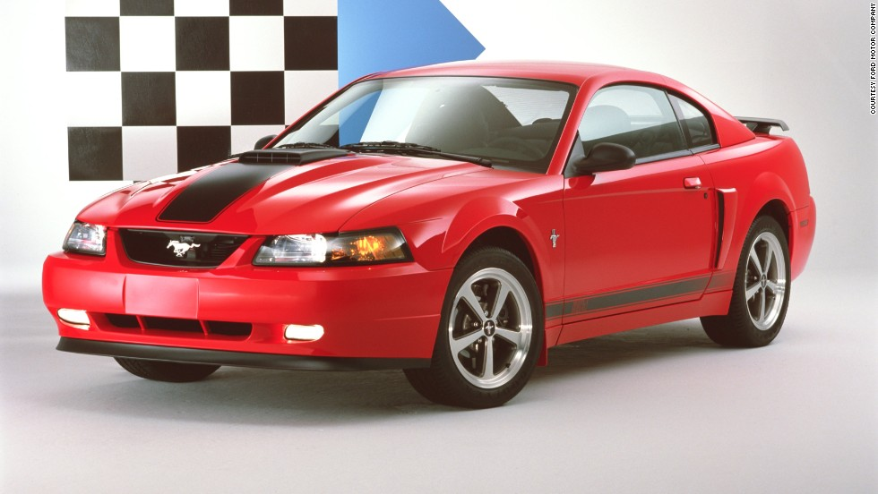 "<strong>2003 Ford Mustang Mach 1 coupe. </strong>The Mach 1 sported a 305-horsepower V-8 engine and a signature ram-air ""Shaker"" hood scoop. The interior was equipped with 1960s-style ""comfort weave"" seats trimmed in black leather."