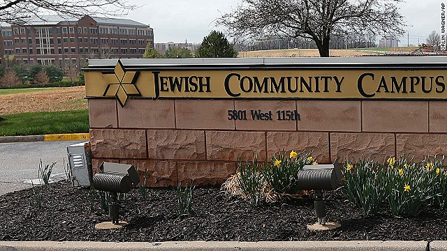 An Overland Park police officer and Kansas State Trooper guard the entrance of the Jewish Community Center after a shooting in Overland Park, Kansas, Sunday, April 13.