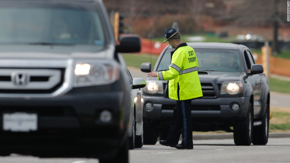 A Kansas state trooper controls traffic at the entrance of the Jewish Community Center on April 13.