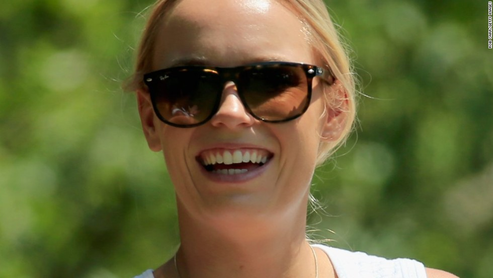 Rory McIlroy's fiancee, tennis star Caroline Wozniacki, had something to smile about on the last day as he carded a fine three-under-par 69 to finish level par for the tournament.