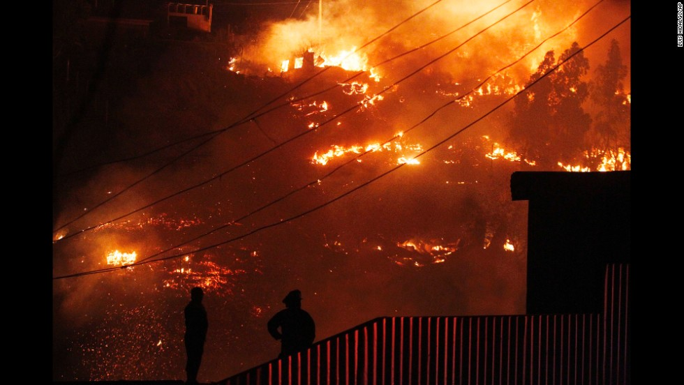 People watch the flames destroy homes in Valparaiso.