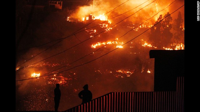 People watch as the flames destroy homes in Valparaiso.