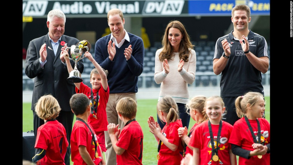 New Zealand Rugby CEO Steve Tew, left, the royal couple and All Blacks captain Richie McCaw congratulate the winners of the the young players' rugby tournament at Forsyth Barr Stadium in Dunedin on April 13.