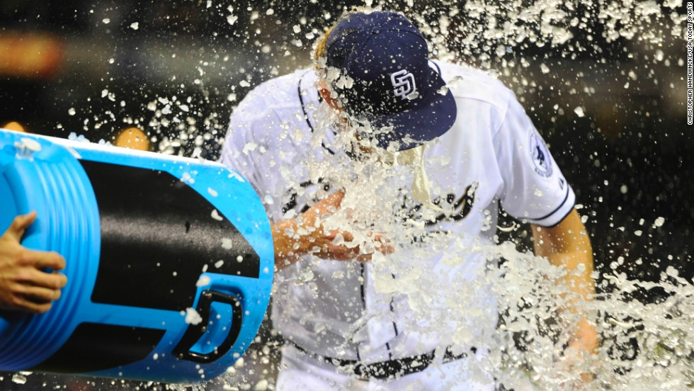 San Diego pitcher Andrew Cashner is dumped with Powerade after he threw a one-hitter Friday, April 11, in a home game versus Detroit. San Diego won 6-0.