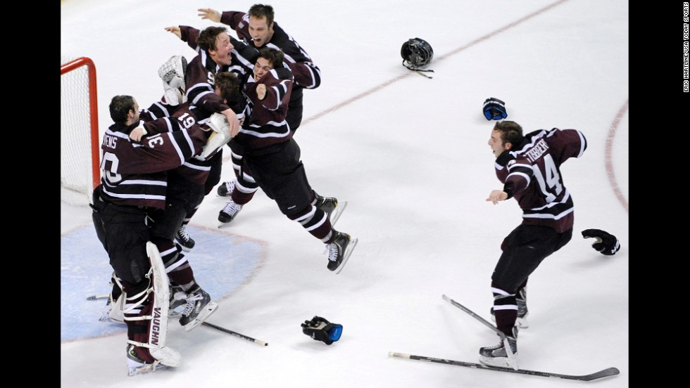 Members of the Union College men's hockey team celebrate after defeating Minnesota 7-4 and winning the NCAA championship on Saturday, April 12. It was the first-ever title for Union, a small private school in Schenectady, New York.