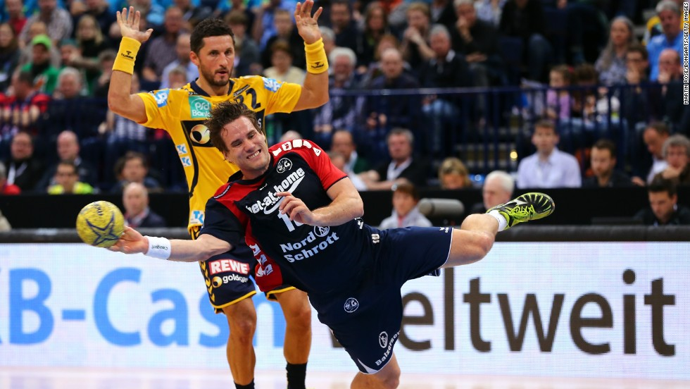 Flensburg-Handewitt's Thomas Mogensen, right, competes with Alexander Petersson of Rhein-Neckar Loewen during a DHB-Pokal handball semifinal Saturday, April 12, in Hamburg, Germany. Flensburg-Handewitt won the match 30-26 but would go on to lose to Fuchse Berlin in the final.<br />