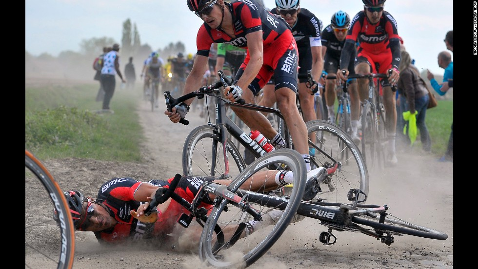 Greg Van Avermaet crashes Sunday, April 13, during the 112th Paris-Roubaix cycling race in Roubaix, France. Dutch cyclist Niki Terpstra won the one-day road race, which was first held in 1896.