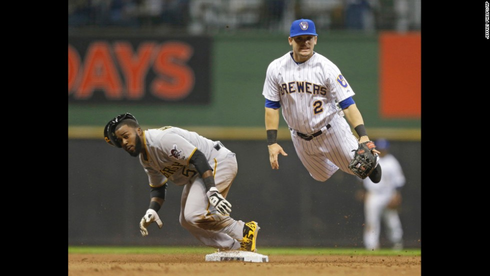 "Milwaukee's Scooter Gennett, right, hangs in the air Saturday, April 12, after throwing to first base to complete a double play against Pittsburgh. Milwaukee won the game 3-2 for their eighth straight victory. <a href=""http://www.cnn.com/2014/04/08/worldsport/gallery/what-a-shot-0408/index.html"">See 33 amazing sports photos from last week</a>"