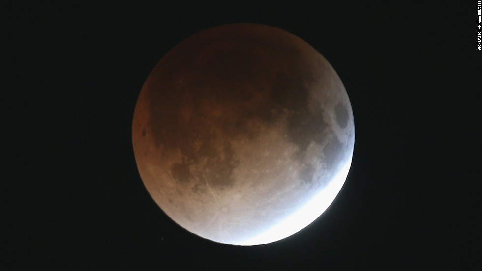 The moon begins to take on a reddish hue early Tuesday from Miami. The moon did so as it appeared in different phases between 2 and 4:30 a.m. ET.