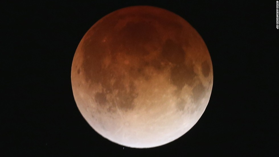The total lunar eclipse is seen in this image taken from Miami. Unlike solar eclipses, lunar eclipses are safe to view with the naked eye and don't require special filters.