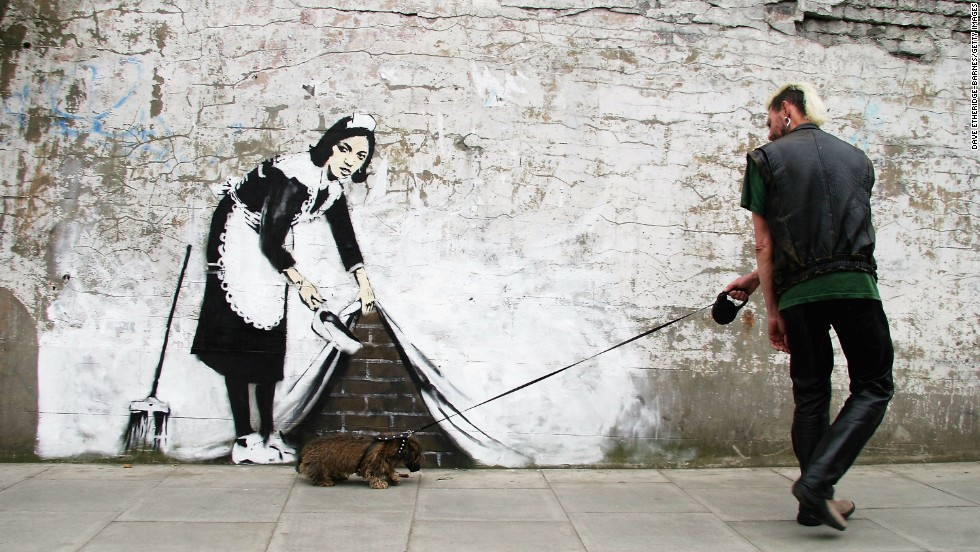 A man walks past a Banksy piece in London in 2006.